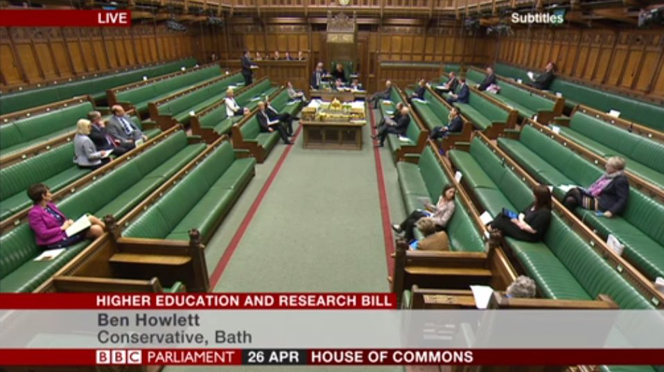 The photo shows the house of commons during the Higher Education Bill debate. Most of the seats are empty with only around 15 MPs in attendance.