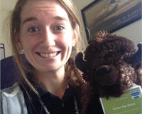 Picture shows Molly Browne (Sports Officer) and Victor the Bison stuffed toy in her office